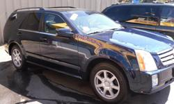 Make Cadillac Model SRX Year 2005 Colour Blue kms 130000 Trans Automatic Luxury 7 passenger SRX Great driving vehicle with Air Conditioning | Airbag (Driver) | Airbag (Passenger) | Airbag (Curtain) | Airbag (Side Impact) | Sunroof | 3rd Row Seating |