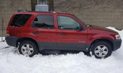 Make Ford Colour RED Trans Automatic kms 187545 05 Ford Escape Hybrid in Very Good Interior & Exterior Shape, Hybrid Battery in Excellent conditions, AWD, 4 Cylinder 2.3 L, Tires in Good Condition and Ready to drive for winter. Buy with confident. Comes