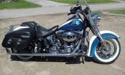Low km Canadian bike in excellent condition with many extras.  Two tone Cobalt blue & Glacier white pearl. Quick release windshield, upgraded chrome rims, Samson true dual exhaust system, Lindy engine guards, blue LED boogie lights to show off engine
