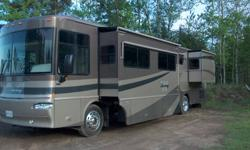 2005 Winnebego Journey, 40' Class A, with 3 slides, 13,327 miles, 350 Cat Motor, Allison 6 sp trans., exhaust brake, polished aluminum wheels, full body paint, leather J lounge, power queen couch and captain seats.  Corian counter top and table, 4 door
