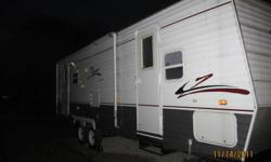 Sleeps 6, large dinette and couch tipout, stove,oven,microwave, double sink, gas/electric fridge and freezer, T/V, built in stereo with built in speakers throughout the trailer, 3pc bathroom, master bedroom at the front with a queen bed, forced air