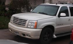 Make Cadillac Year 2006 Colour Pearl White Trans Automatic Fully loaded 8 passenger All Wheel drive luxury SUV. This vehicle drives well with newer tires and brakes. Winter is here, if you need a dependable vehicle that drives through snow with ease, has