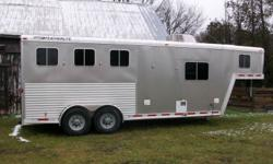 2006 Featherlite horse trailer for sale. Fits up to 3 horses. Base measures 20' x 7' wide. 8' gooseneck. Cowboy shower inside and outside. Living quarters includes stove, refrigerator, sink, dining area, sleeping area, stereo, microwave, heater, air
