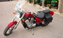 One owner, equipped with Memphis Shade windshield and Willy & Max saddlebags.  Selling certified