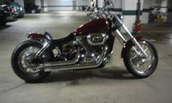 """It was bought new in winter 2008 (thats less than 3 years old.)  it has  about $4000 worth of extra work and parts put in to it. Harley high rise handle bars, 4"""" risers, spiked fork caps, spiked chrome and flame grips, candy drop mirrors with integrated"""