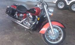 2006 Honda Shadow 750, Cobra Dual Exhaust, lots of chrome on bike, comes with Saddle Bags, Windshield, Passenger Seat, Original Muffler, extra oil filter and oil. This bike has never been dropped and runs very well, was only driven around town once in a