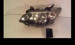 2006 Mazda MPV driver side left headlight assembly (new - never used)