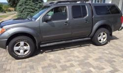 Make Nissan Model Frontier 4WD Year 2006 Colour Grey kms 222000 Trans Automatic 2006 Nissan Frontier LE Crew Cab 4X4 - 4.0 L V6 - automatic transmission - new LT265/70/17 Cooper Discover AT3 tires - tinted windows - factory moonroof - factory roof rack -