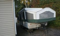 This trailer has a queen and king bed (both of which are heated) and a twin bed.  Fridge, furnace, sink, water pump, ceiling fan, dining table, port a potty, sports rack (2 bikes and a canoe will fit on it).... elecrtic crank for easy set up... Canvas is