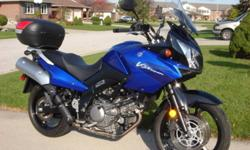 """Upgrades are Mad Stat windshield bracket, 46 liter tail trunk and 3/4"""" lowering links.  Oil change done today(12th change), brake fluid changed in the spring. New sport touring front tire in September, and rear sport touring tire installed August 2009."""