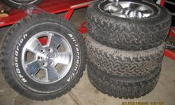 Set of 4 Toyota Tacoma sport rims with tires.  Size LT265/70 R17 BF Goodrich All Terrain T/A   Factory Rims Phone 622-8148