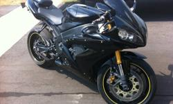 Hi, Im selling my 2006 Yamaha R1 with custome Black paint with 10,212km (Low millage). It has a power commander. The tires are in a good shape (80% thread left on them) and the brakes are good aswell. The front and back lights are integrated. It comes