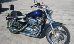 2007 Harley Sportster Custom, metalic blue, passenger back rest,18,500 km. This bike looks and runs great. Price includes certification.