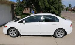 Make Honda Colour White Trans Automatic kms 154000 Excellent shape and well maintained 2007 Honda Civic EX. Fully loaded including air conditioning, sunroof, power mirrors and locks, heated mirrors, and alloy wheels. Two sets of tires included which are