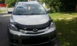 Mazda5 for sale !!! Price reduced... 6 Passenger, with LOW KILOMETER! Car is great for a family of 5 or 6. Has winter and summer tires mint condition. SAFETY & E-TEST ready to be driven in the summer. Options: -Power Windows -Power Locks -Cruise Control