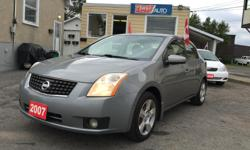 Make Nissan Colour Grey Trans Automatic kms 157549 HELLLOO OTTAWAAAAA!!! GREAT ON GAS! Air Conditioning, Anti-Lock Brakes (ABS), CD Player, Hubcaps, Power Mirrors, Power Steering, Power Windows, Rear Defroster, Power Locks, Cup Holder, Daytime Running