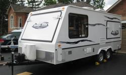 2007 Starcraft travelstar 21SB hybrid with 2 queen beds and 1 double bed that folds easily with aircraft cables and no poles outside (new design). Easy up and down unlike most trailers on the market. 8' wide trailer that extends to 30' when opened up.