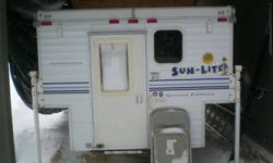 2007 Sunlite Eagle Truck Camper Deluxe .... THINK SPRING Pop-up light weight camper Weighs approximately 1,200 lbs Fits 6'6 to 8' box Sleeps 4 people 20 gallon water tank for sink Propane, electric & DC fridge Propane counter top stove and furnace