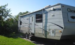 2008 Cherokee By Forest River   Bought Brand New right from the dealer. Custom made 30' Cherokee Travel Trailer by Forest River.   Features Include: 2 Slide Outs (1 Bedroom Single and 1 Living Room/Dining Room Double Slide, Full Awning, 3 Way Fridge,