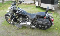 This beauty is exceptionally well maintained. Stored indoors ALLWAYS. Equipped with genuine H-D ?Nostalgic? series add-ons, such as grips, foot boards front and rear, adjustable highway pegs, brake and shift petals. Chrome helmet lock, and engine ?crash?