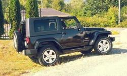Make Jeep Colour Black Trans Automatic kms 117000 REDUCED..$17,000..3.8 litre V6 Auto,117,000klm,all new 275/65/R18 all terrain tires,new windsheild,A/C,power windows/locks,stereo with subwoofer,Comes with both the Hard and Soft tops...Excellent