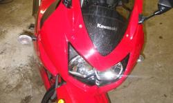 Selling a 2008 Kawasaki Ninja 250R (Red). It has been lightly used with only 4015 km. It has never been dropped or damaged, and garaged unused for the 2011 riding season while I was out of town for school. The bike is in good condition overall. The bike