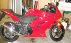 Hello, I am selling my 2008 Kawasaki Ninja 250R (Red). It has been lightly used with only 4015 km. It has never been dropped or damaged, and garaged unused for the 2011 riding season while I was out of town for school. The bike is in good condition