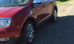 Make Lincoln Model MKX Year 2008 Colour Red Trans Automatic I am selling my 2008 Lincoln MKX. It is the elite model, has abosultely everything. Features: -20 Inch Factory OEM Rims -Navagation -Panonramic Vista roof -THX Audio System -Leather seats -Heated