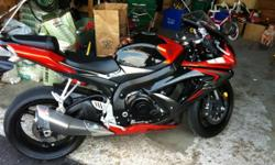 MINT 2008 GSX-R in black/orage serious head turner, hottest bike on the market, faster than any 600, insures the same as my previous 600, amazing bike, second owner, only selling due to financial reasons. very very low km this bike is practacally new, no