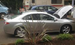 Make Acura Model TSX Year 2009 Colour Silver kms 115484 Trans Automatic This is a must see car for anyone looking for a cool car at an awesome price! Must sell as our daughter has outgrown the coolness for something to tote her little one around in that