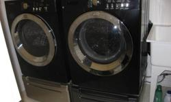 2009 Frigidaire Affinity Black Front Load Washer and Dryer, dryer is electric, large capacity, with pedestals (pedestals are not an exact match), lightly used by a family of 2, energy/water efficient, pedestals have lots of storage in them, and keeps