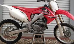 For Sale 2009 Honda CRF 450 complete motor rebuild ( engine has 5hrs of use ) front forks have just been serviced ( dust seals , fork seals and oil ) oversized front rotor new shifter hour meter from new original owner - i recently just put around $3400