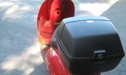 Nearly new (< 400 KM) Honda Jazz scooter. Bought new in Mar/11 from Honda dealer.  Includes all factory options: front basket, rear luggage pack, windshield.   Honda MSRP is $3,000 plus approx. $600 for options.  Selling for $2100 complete. Works