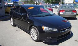Make Mitsubishi Model Lancer Year 2009 Colour Black kms 203000 Trans Automatic 2009 Mitsubishi Lancer Loaded with 203000 km , Nice Car with Air conditioning . Will come Certified. Come Visit Us Today 916 Montreal Road Ottawa Ontario We are here to Serve