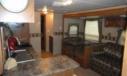 The 32KS has plenty of space for the whole family. The kids will enjoy the suite in the back of the unit where you will find a booth dinette that transforms into a bed and located above the dinette is the flip up bunk. Across from the dinette you will