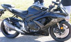 I have a Black 2009 GSX-R 600 for sale. The bike is in mint condition. has around 12,000 kms on it. I purchased it at gords for $12,300 leftover 2009 stock. I am moving, But im here for the next week so im willing to let it go for $6300 firm if i can sell