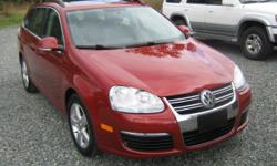 Make Volkswagen Model Jetta Wagon Year 2009 Colour RED kms 118000 Trans Automatic Best Price Anywhere ! * 4 Cyl. 2.5 Auto Transmission * 118000 KM * Red Exterior With Grey Leather Interior * Anti Theft * CD Player * Dual Air Bag * Intermittent Wipers *