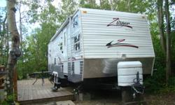 2009 29ft  Zinger travel trailer. This travel trailer has two slides. The one slide is the queen size bed and the other slide is the table and chesterfield. Bunk beds are in the front the trailer in their own room! Great for kids or great for storage,