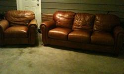 """Very nice brown leather couch from Sears originally $3000 asking $200 obo. Cat scratches on one leg (photo posted) and some sun damage to arm of couch that faced our window. Dimensions of chair: 43 x 37"""""""""""" of couch:80 x 36"""""""