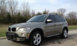 Make BMW Model X5 xDrive30i Year 2010 Colour brown kms 93000 Trans Automatic This 2010 BMW X5 3.0i X-Drive is a midsize luxury SUV with a strong 3.0 liter V6 engine, a beautifully appointed interior with brown leather seats, and ample cargo space. This