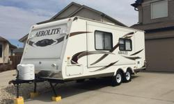 Fully loaded 2010 Dutchmen Aerolite model 241 hybrid travel trailer, asking $16,800 obo: - original owner, bought new - extended transferable warranty until May 2018, - 24 feet long (approx. 34' with bunk ends opened up) - power slide out (on the side of