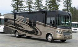 2010 Georgetown 38' motor home. Ford Triton V10, 5 speed automatic transmission, triple slides with awning toppers. 2 TVs, side by side stainless steel fridge, combination Microwave and Convection oven, Queen bed, Dual AC and Furnace, leather furniture,,