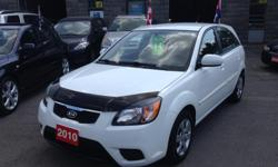 Make Kia Model Rio5 Year 2010 Colour White kms 80000 Trans Manual HELLLLOOO OTTAWAAA!!! ONLY 80,000 KM!!! AM/FM STEREO, AIR CONDITIONING, CD PLAYER, DAYTIME RUNNING LIGHTS, DUAL AIRBAG, INTERMITTENT WIPERS, KEY LESS ENTRY, PASSENGER AIRBAG, POWER BRAKES,
