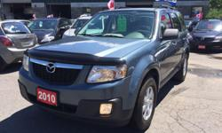 Make Mazda Model Tribute Year 2010 Colour Blue kms 135591 Trans Automatic NO ACCIDENTS - CLEAN CARPROOF...Nice Family SUV! Air Conditioning, Anti-Lock Brakes (ABS), CD Player, Power Mirrors, Power Steering, Power Windows, Rear Defroster, Power Locks, Cup