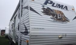 2010 Puma PTBSS 39ft Front bunkroom,rear King size bed with slide, free standing dinette, full size fridge and stove, microwave, pantry, walkthru bathroom with garden tub, hook up for washer/dryer, A/C, patio doors, electric/propane hotwater heater,