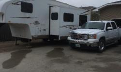 26ft 5th wheel, sleeps 8 with 42 in. wide bunks across the back, Queen bed in front, couch and dinette booth converts to bed - 4 piece bath with tub, shower, sink &amp toilet - large couch/dinette slide - fridge/freezer/microwave/3 burner stove range hood