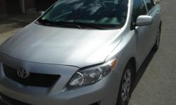 Make Toyota Model Corolla Year 2010 Colour SILVER kms 103825 Trans Manual STANDARD 5 SPEED 4 CYLINDER . 103824 KMS Silver with grey interior Air conditioning, am/fm/cd/mp3, power door locks, power windows, 15 inch steel rims car was insurance write off
