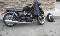 This bike is in brand new condition, comes with add ons---tachometer, thruxton seat and seat cowling, straight bars and bar end mirrors, and stock seat .