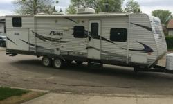 """2011 30' PUMA Camper Trailer with OUTSIDE KITCHEN - Excellent Condition! Original owner, non-smoking, no pets and seldom used. This camper needs to be seen to be appreciated. It still has that """"new camper"""" smell, in fact the 3-burner stove has never been"""