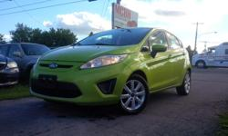 Make Ford Model Fiesta Year 2011 Colour Green kms 161000 Type: Hatchback Status: Used Doors: 4 Kilometers: 161000 Exterior Colour: Green Interior Colour: Black Fuel Type: Gas Cylinders: 4 Transmission: Automatic Drive: FWD Options : Air Conditioning,